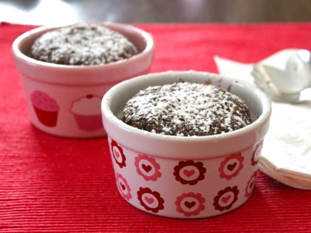 Two gluten-free chocolate cakes in small ramekins.