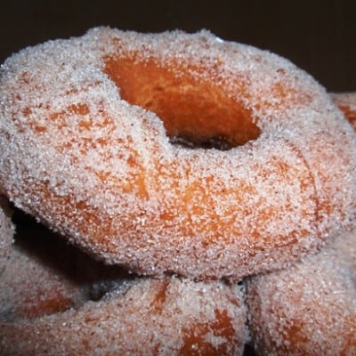 Old Fashioned Gluten-Free Doughnut coated with granulated sugar.