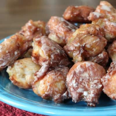 Gluten-Free Apple Fritters on a blue plate.