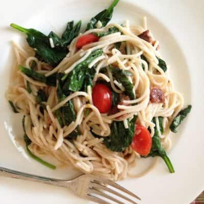 Gluten-free BLT pasta on a white plate.