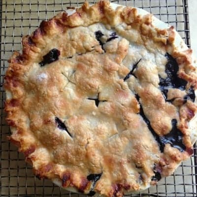 Gluten-Free Blueberry Pie on cooling rack.