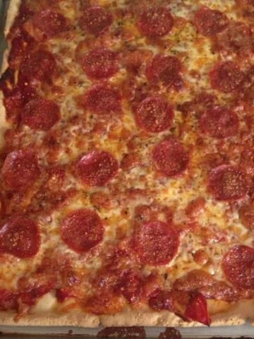 Gluten-free pepperoni pizza in a pan.