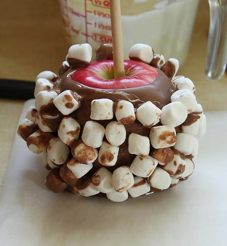 Apple dipped in milk chocolate and covered in marshmallows.