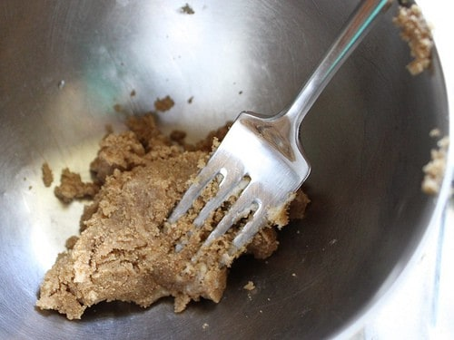Brown sugar and butter mixed together into a thick paste in a bowl.