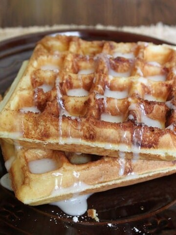 Gluten-Free Cinnamon Bun Waffles with sugar glaze.