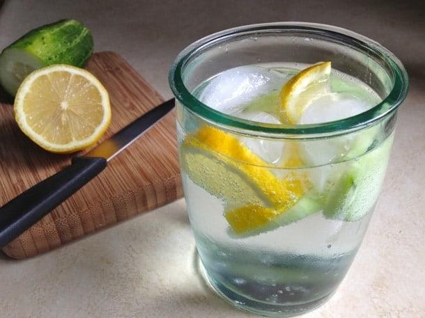 Glass of lemon cucumber water.