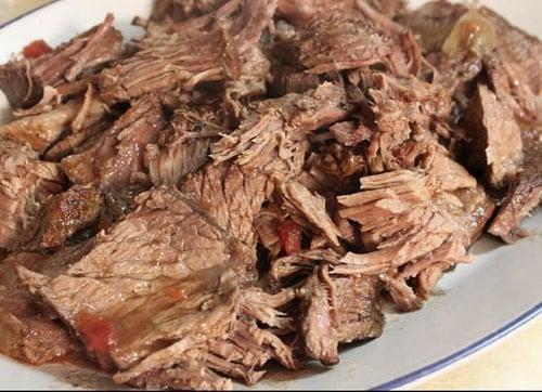 Shredded paleo pot roast on platter.