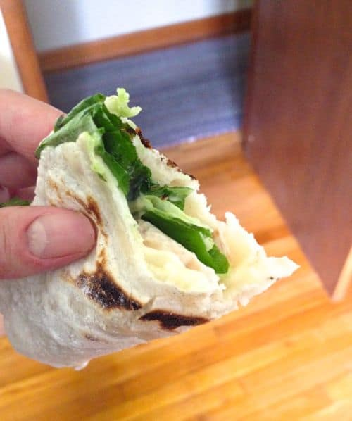 Gluten-Free flour tortilla filled with lettuce, cheese, and turkey.
