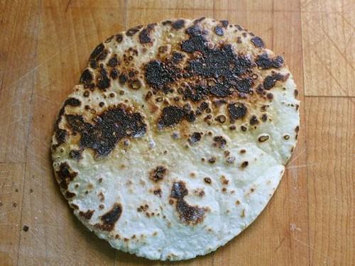 Burnt gluten-free flour tortilla.