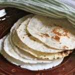 Gluten-free flour tortillas on a plate.