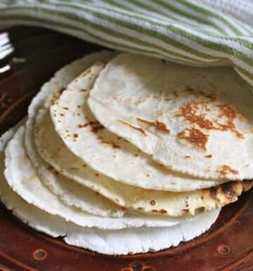 Gluten-free flour tortillas on plate.
