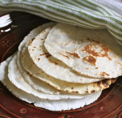 Gluten-free flour tortillas on plate.