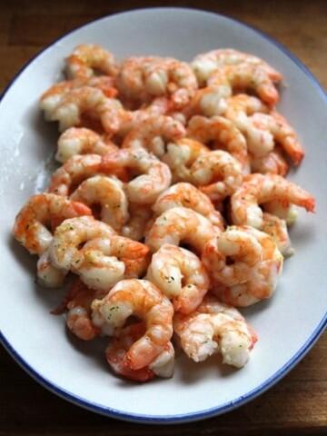 Cooked garlic shrimp on platter.