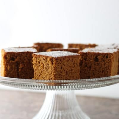 Gluten-Free Ginger Pumpkin Bread on a glass cake stand.