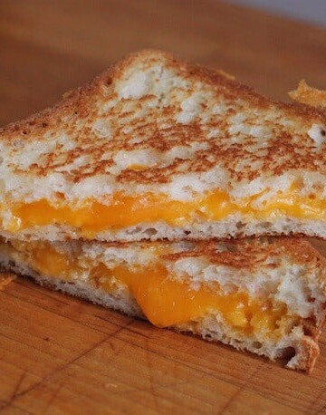Gluten-free grilled cheese on a cutting board.