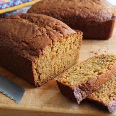 Gluten-Free Pumpkin Bread sliced on cutting board.
