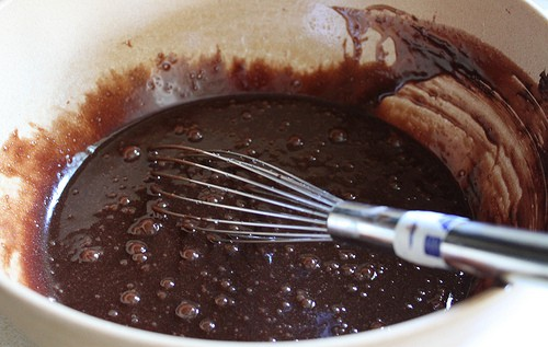 Gluten-free brownie batter whisked until smooth.