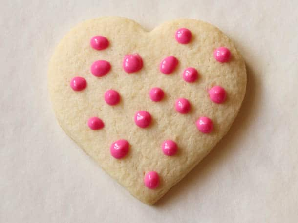 Gluten-free sugar cookie with pink chocolate polka dots.