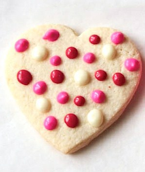 Gluten-free sugar cookie hearts frosted with polka dots.