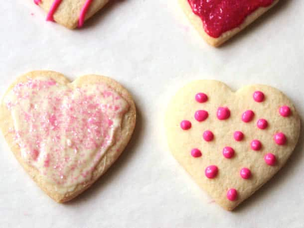 Gluten-free sugar cookies iced with frosting and polka dots.