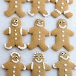 Gluten-free gingerbread cookies on parchment paper.