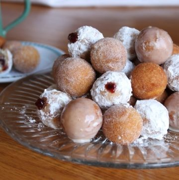 Gluten-free doughnut holes on plate.