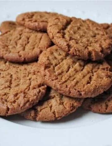 Gluten-Free Flourless Peanut Butter Cookies on a white platter.