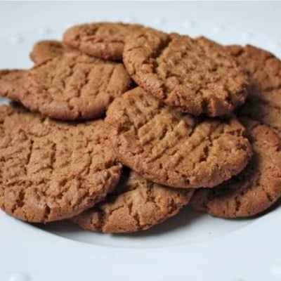 Gluten-Free Flourless Peanut Butter Cookies on a white platter.