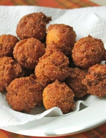 Gluten-Free Hush Puppies on a paper towel-lined bowl.