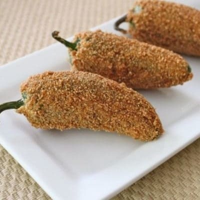 Gluten-Free Jalapeno Poppers on a white platter.
