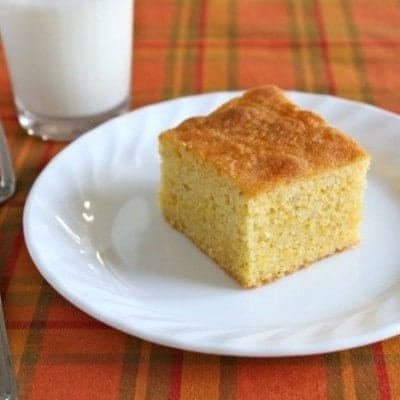 Gluten-free maple cornbread on a white plate.