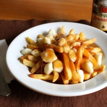 Gluten-Free Poutine in a white bowl.