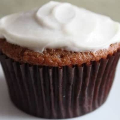 Gluten-Free Spice Cupcake frosted with cream cheese frosting.