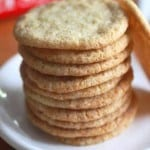 Stack of gluten-free sugar cookies on a white plate.