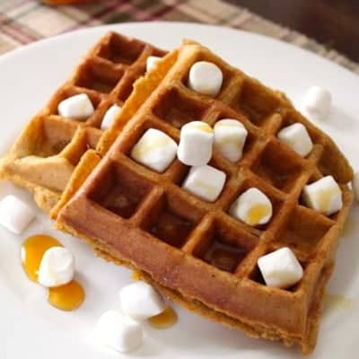 Sweet Potato Casserole Waffles with mini marshmallows and syrup on a plate.