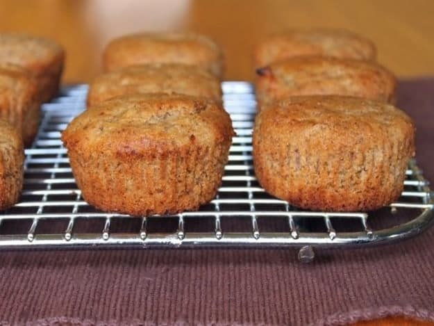 Gluten-free oatmeal vegan muffins on a wire rack.