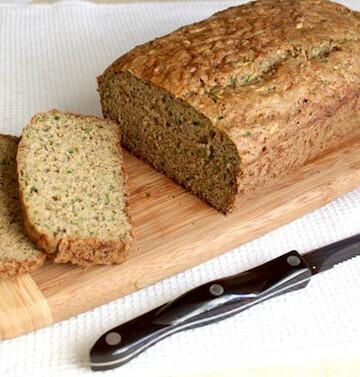 Gluten-Free Zucchini Bread on wood cutting board.
