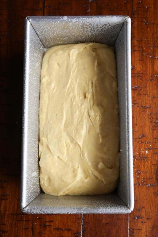 Gluten-free bread dough in greased loaf pan.
