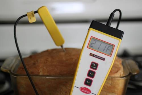 Digital thermometer in gluten-free bread. Thermometer reads 211 degrees F.