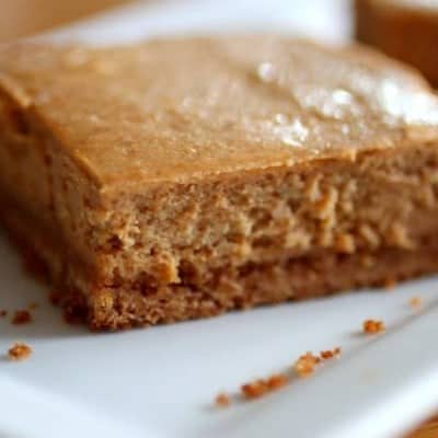 Sweet Potato Cheesecake Bars on a white platter.