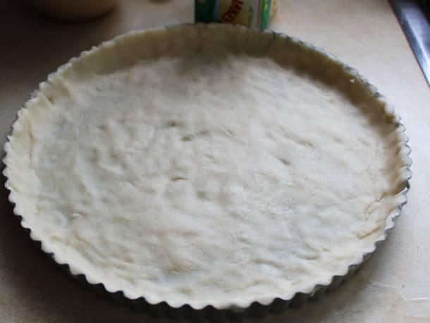 Gluten-free tart dough in pan.