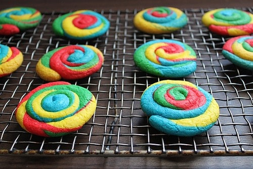 Baked gluten-free tie dye cookies cooling on a wire rack.