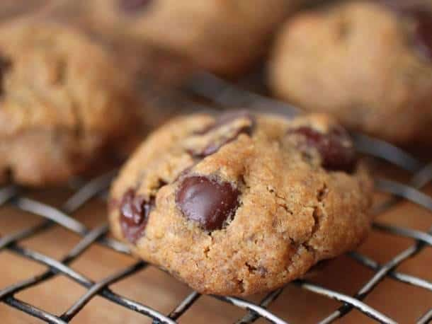 Vegan gluten-free chocolate chip cookie on a wire rack.