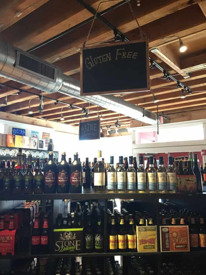 Gluten-free sign over wine display.