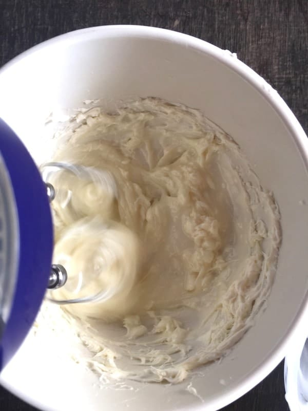 Mixing cream cheese icing.