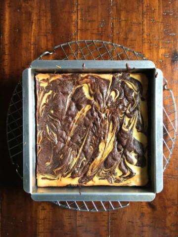 Gluten-free cheesecake brownies in pan.