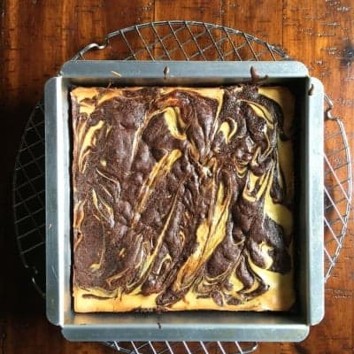 Gluten-free cheesecake brownies in pan.