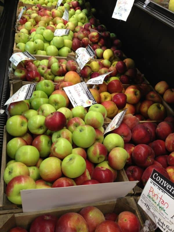 Bins of apples for sale at the market.