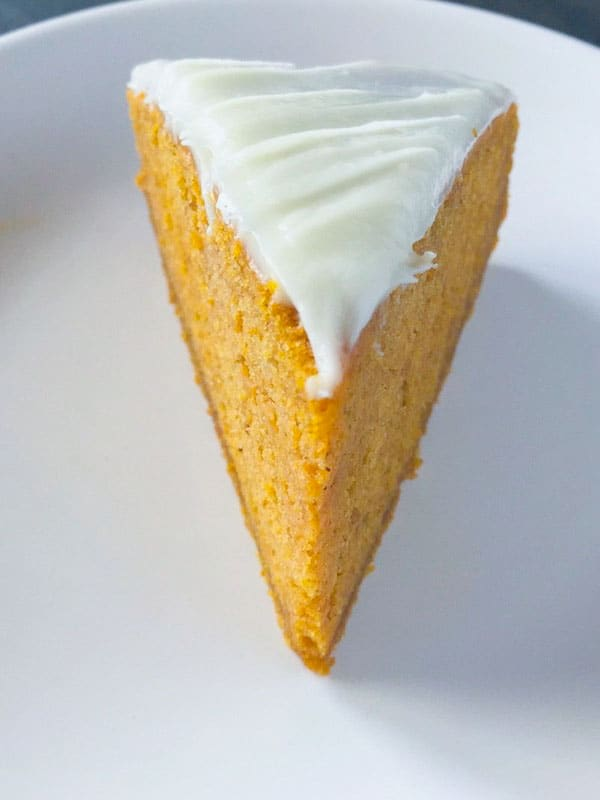 Pumpkin Spice Cake Slice on a white plate.