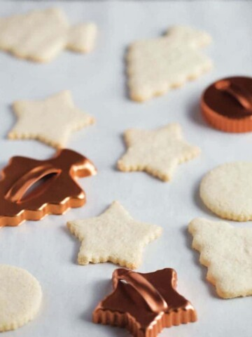 Gluten-free cut out cookies in the shape of a star, tree, and round.